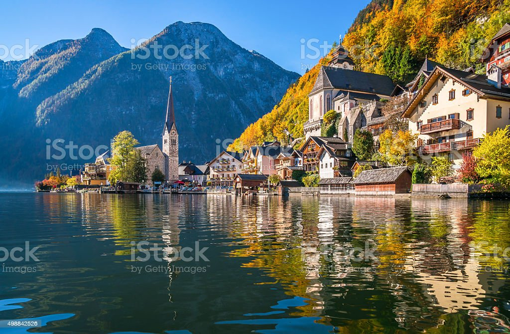 Sunrise in Hallstatt mountain village with Hallstatter See in fall stock photo