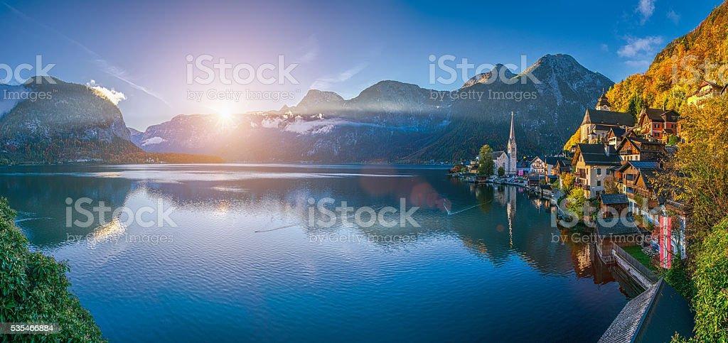 Sunrise in Hallstatt mountain village with Hallstatter See in fall stock photo