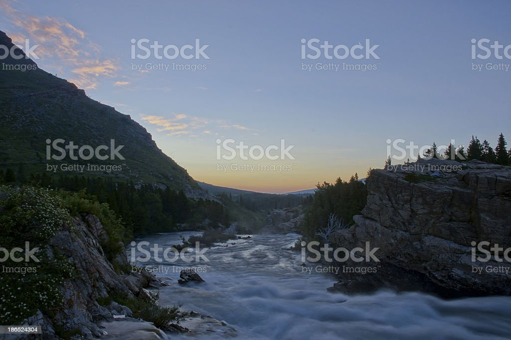 Sunrise in Many Glacier stock photo