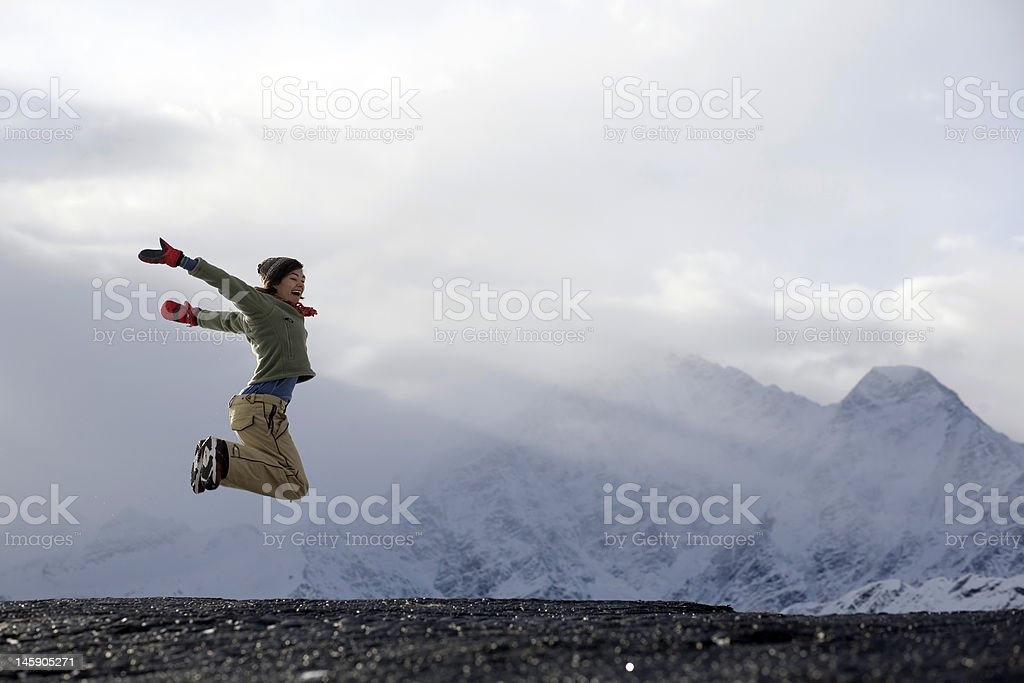 Sunrise in mountains and jumping girl royalty-free stock photo