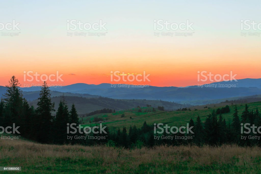 Sunrise in mountains. The sky is red. stock photo