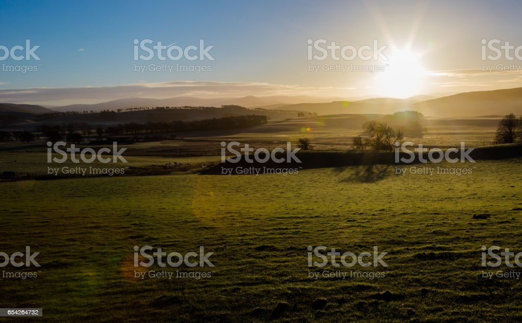 Sunrise in Scottish highlands in winet time stock photo