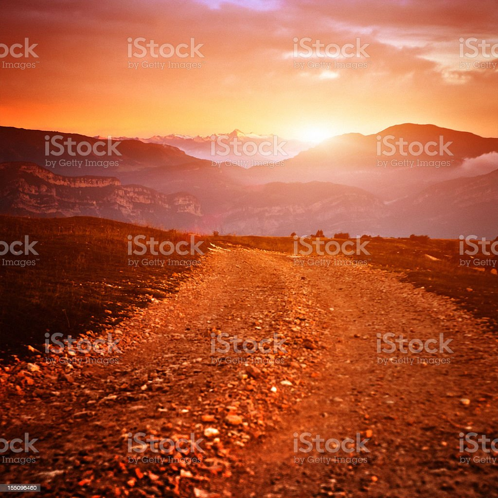 Sunrise in the Alps, Country road stock photo