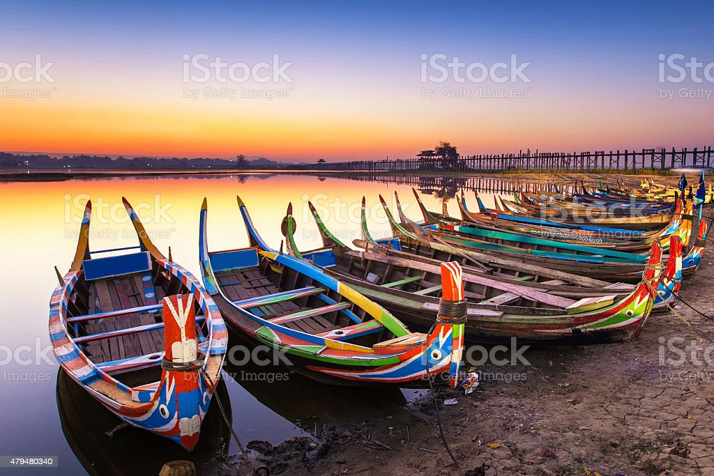 sunrise in the morning at ubein bridge with a boat stock photo
