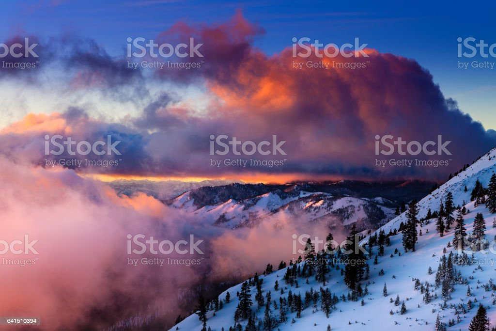 Sunrise in winter on Slide Mountain near Reno, NV on the Mt. Rose Highway. Colorful clouds and snowy landscape. stock photo