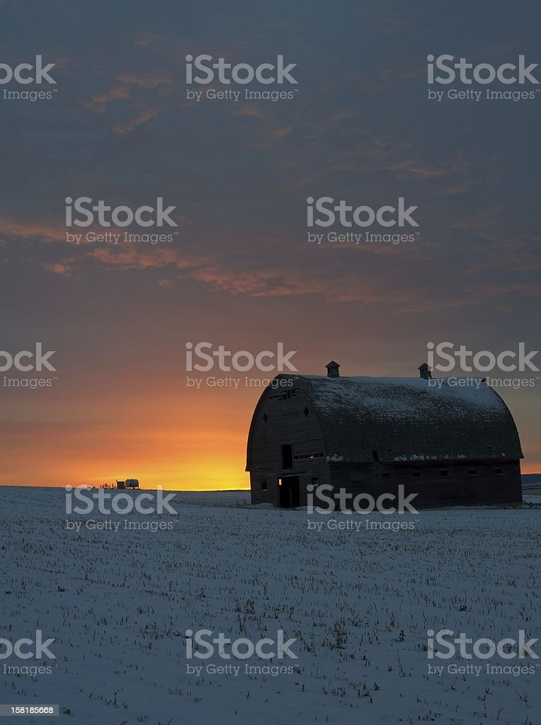 sunrise in winter with abandoned barn royalty-free stock photo