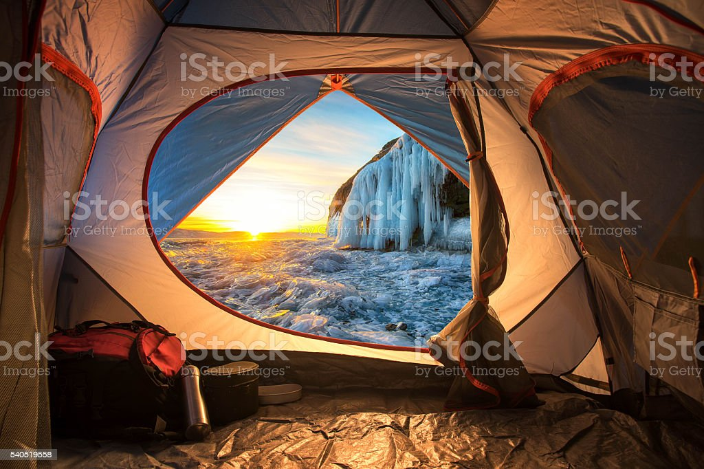 Sunrise inside a Tent. Camping concept stock photo