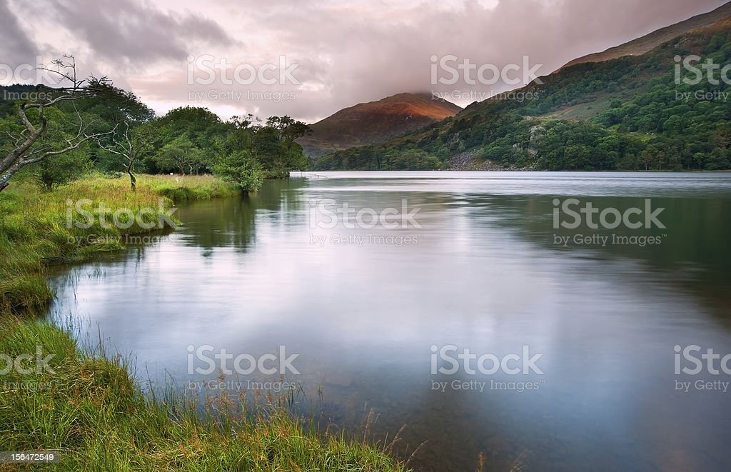 Sunrise landscape over Llyn Gwynant in Snowdonia National Park royalty-free stock photo