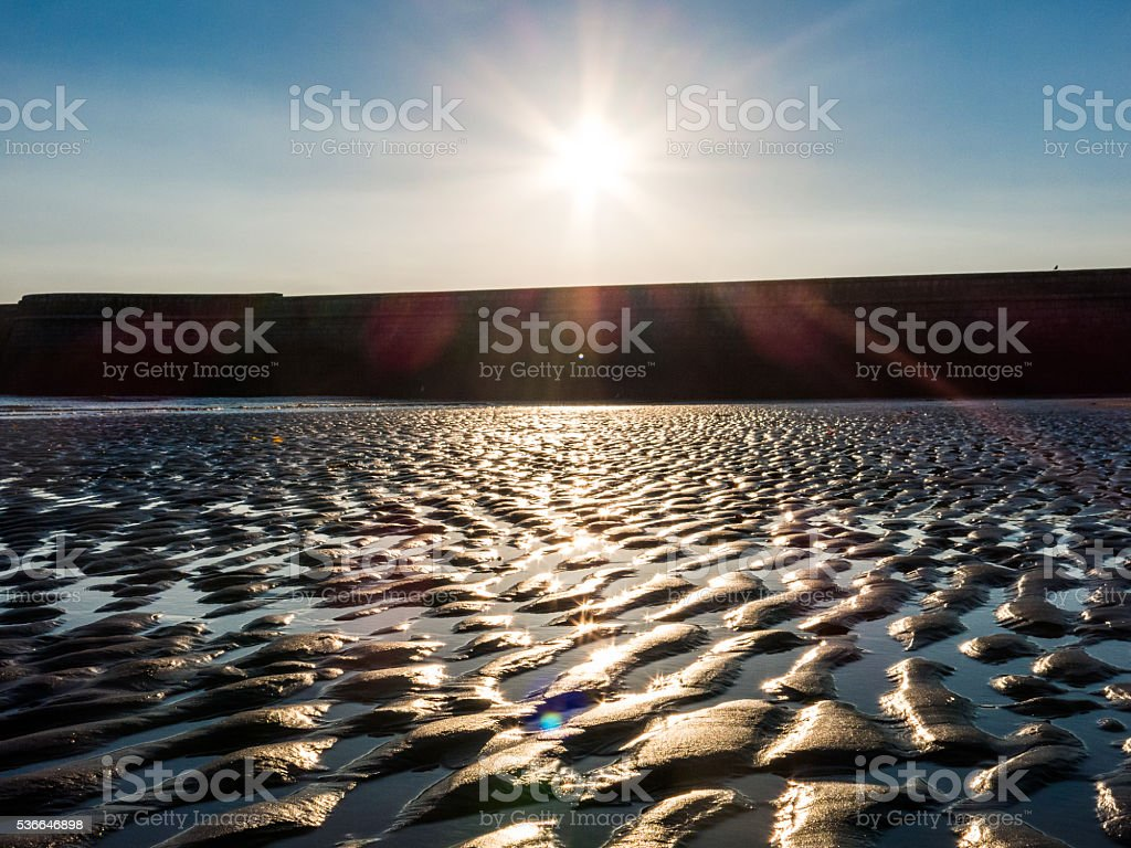 Sunrise Lens Flare Aberdeen Beach Low Tide stock photo