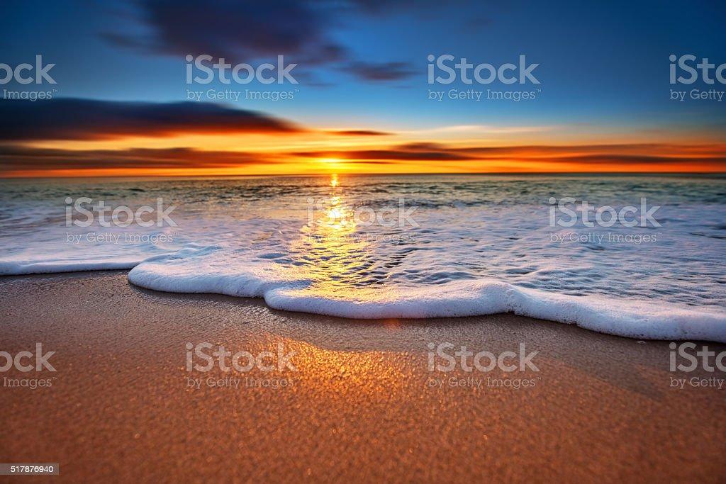Sunrise light shining on ocean waves. stock photo