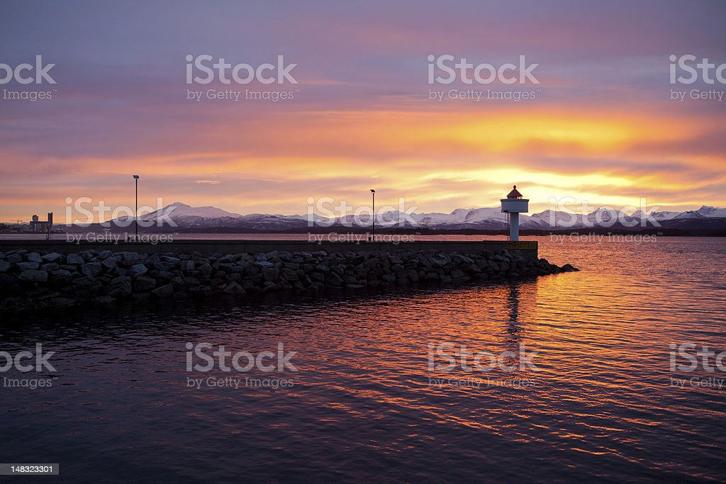 sunrise lighthouse stock photo