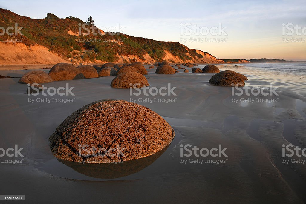 Sunrise, Moeraki Boulders, Otago coast, New Zealand stock photo