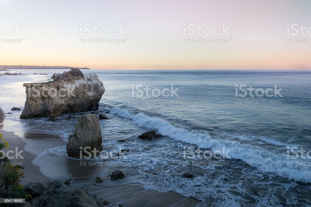 sunrise ocean and rock formations stock photo