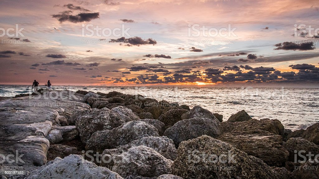 Sunrise of Atlantic at Boca Raton with two people stock photo