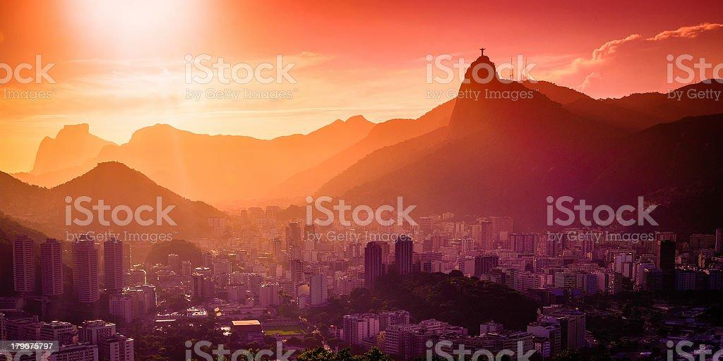 Sunrise on a city nestled at the bottom of hillside stock photo