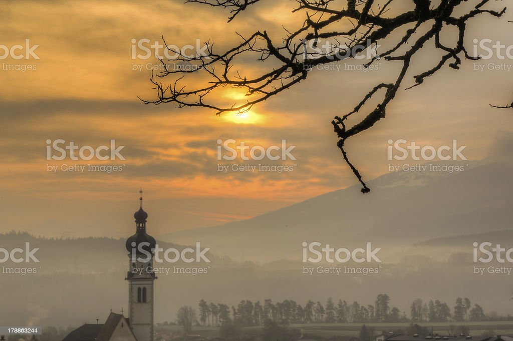 Sunrise on a foggy morning in the Alps. royalty-free stock photo