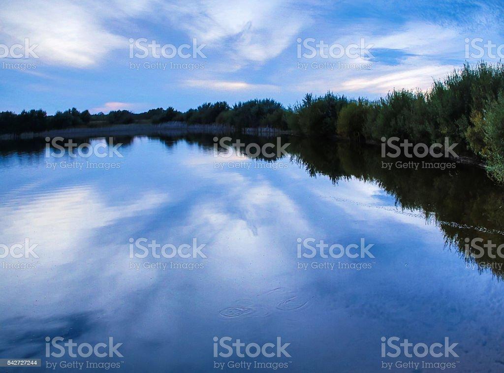 Sunrise on a Foggy Mountain Lake stock photo