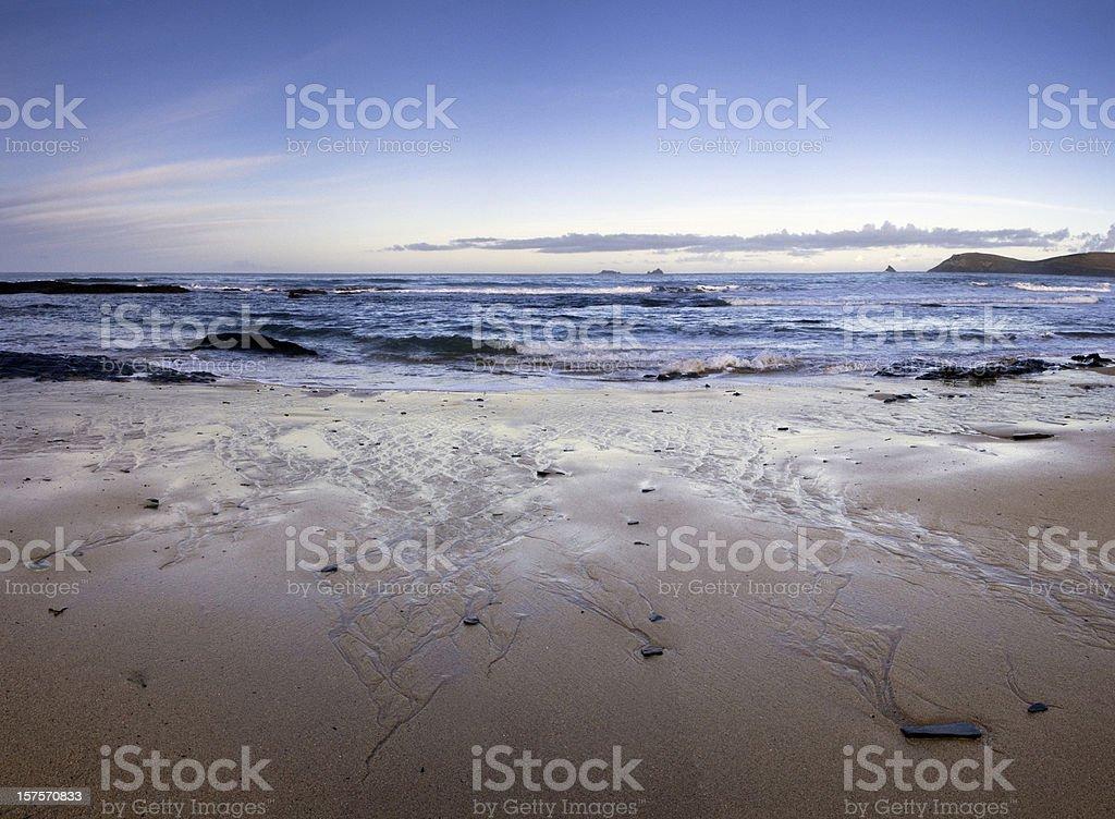 Sunrise on a remote Cornish beach, panorama. royalty-free stock photo