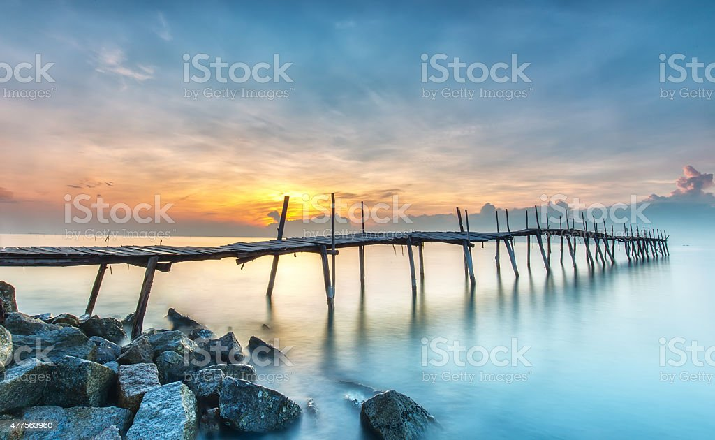 Sunrise on a wooden bridge stock photo