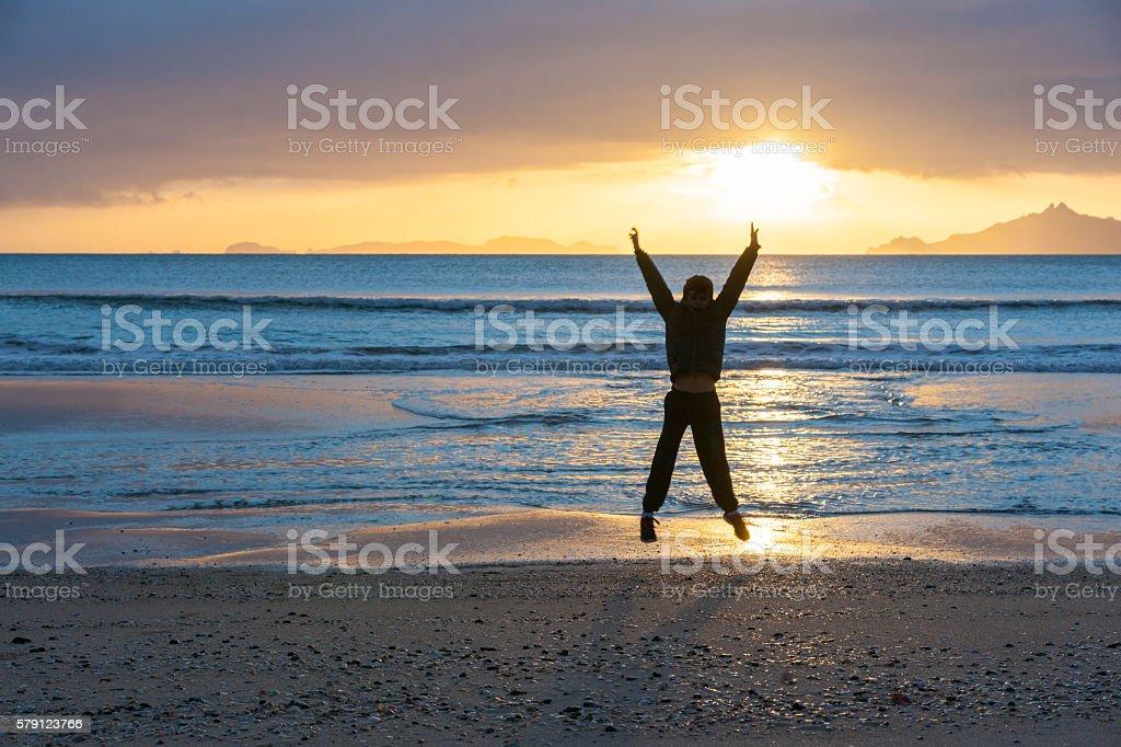 Sunrise on beach Waipu Cove stock photo