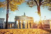 sunrise on Brandenburger Tor in Berlin in golden autumn