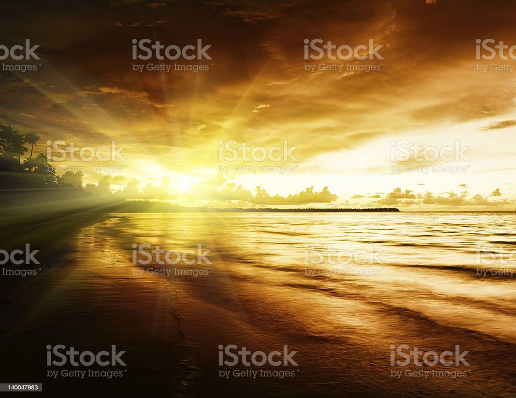 sunrise on Caribbean beach royalty-free stock photo
