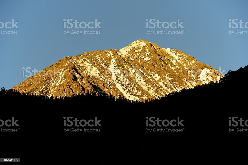 Sunrise on Castle Peak in Colorado royalty-free stock photo
