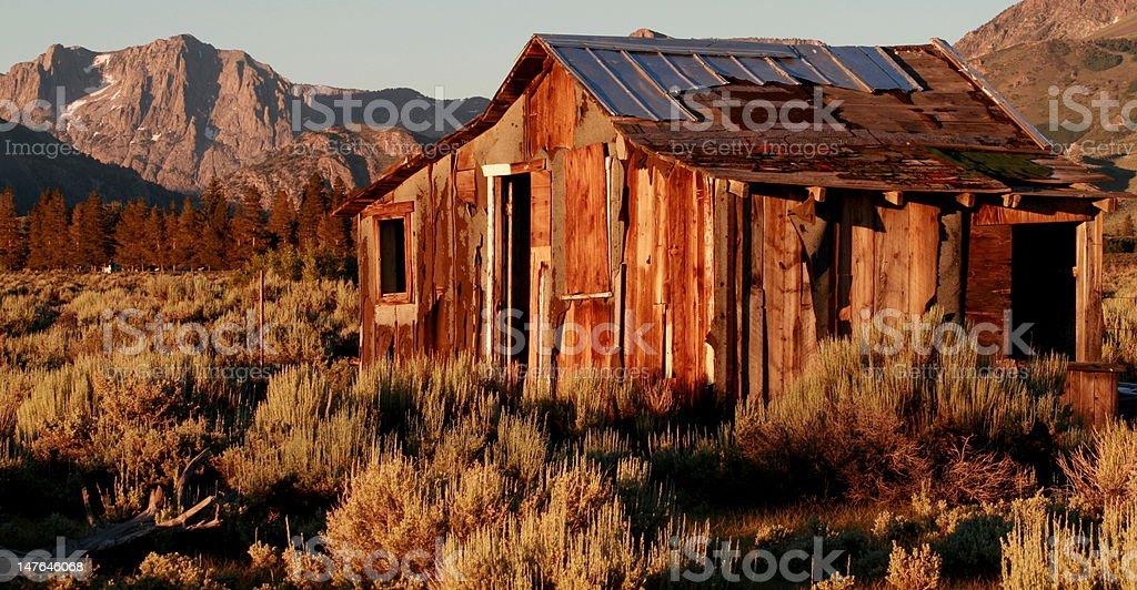Sunrise on Deserted Cabin royalty-free stock photo