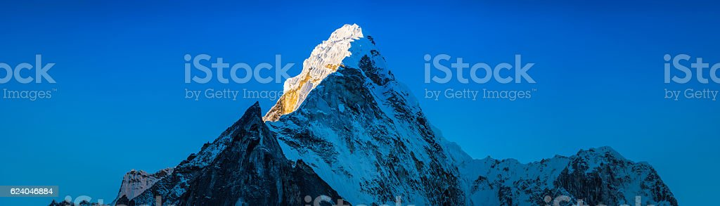 Sunrise on dramatic snow capped mountain peak Ama Dablam Himalayas stock photo