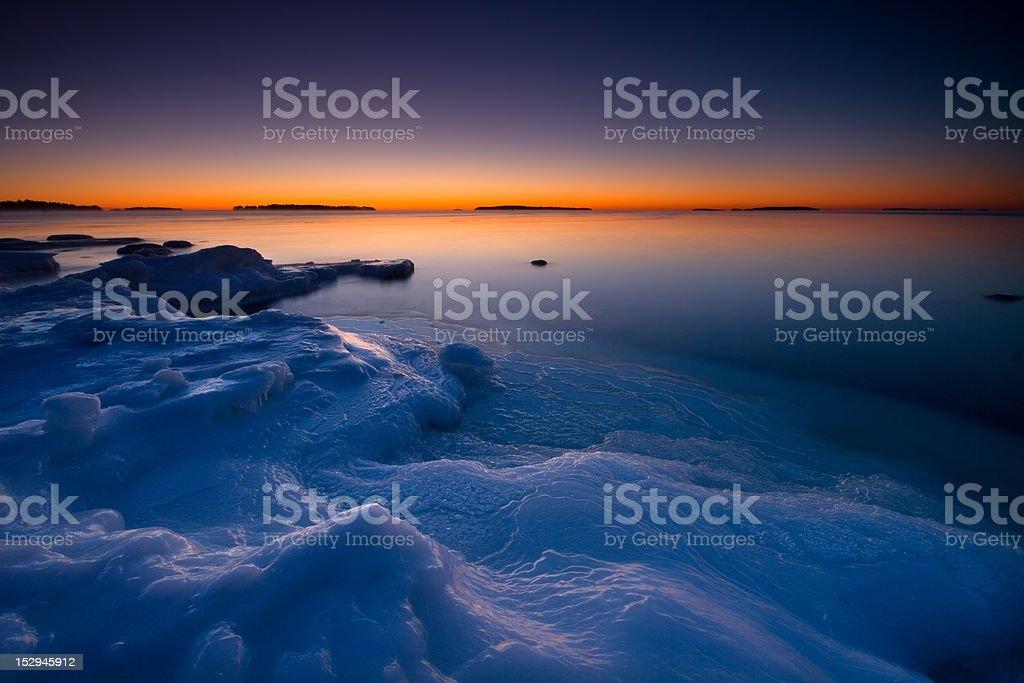 Sunrise on icy beach royalty-free stock photo