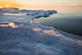 Sunrise on icy shore of Lake Superior in winter