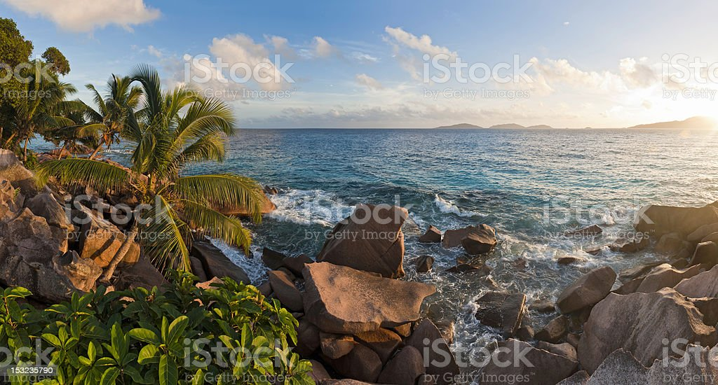 Sunrise on idyllic tropical island palm trees surf Seychelles Africa royalty-free stock photo
