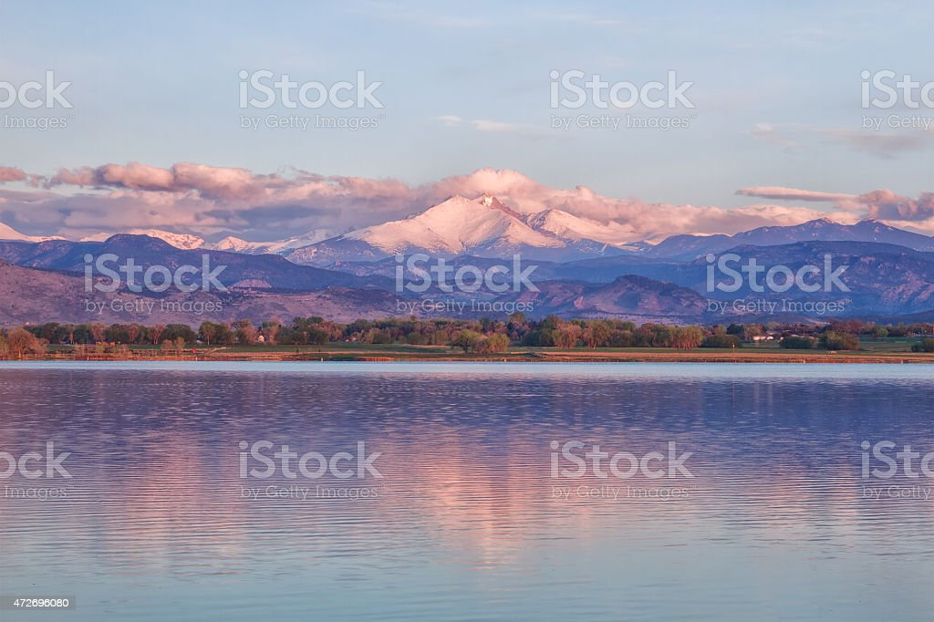 Sunrise on Long's peak and McIntosh Lake Colorado stock photo