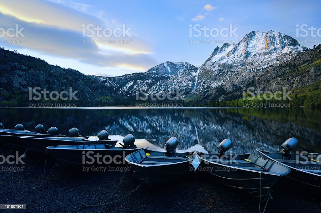 Sunrise on Silver Lake With Reflections and Docked Boats stock photo