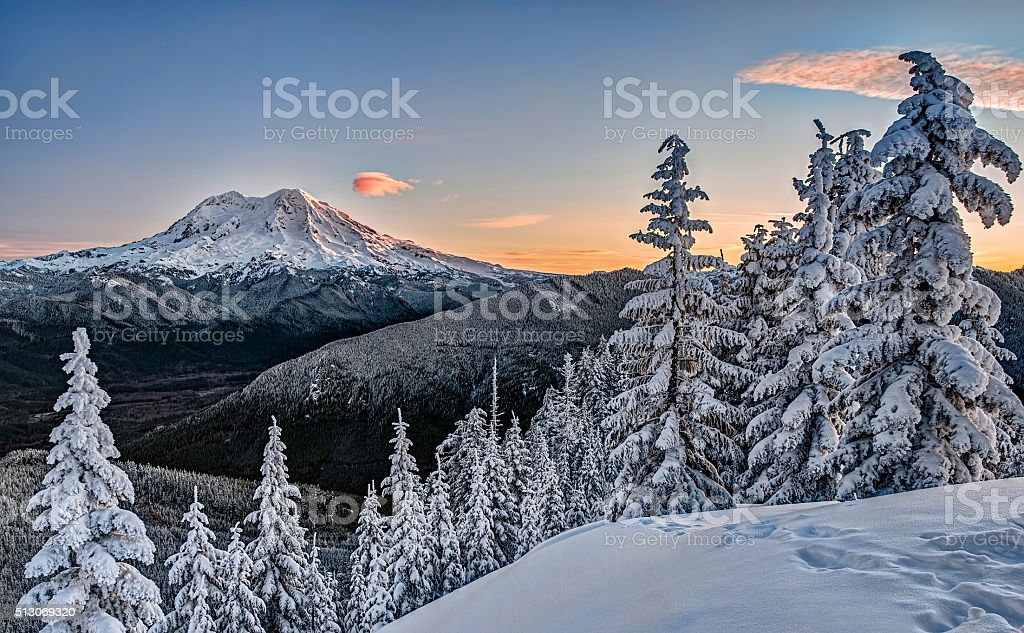 Sunrise on Snowy Mount Rainer in Cascade Mountains stock photo