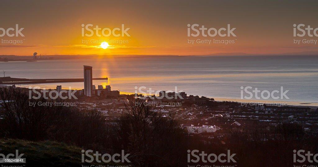 Sunrise on Swansea city south Wales stock photo