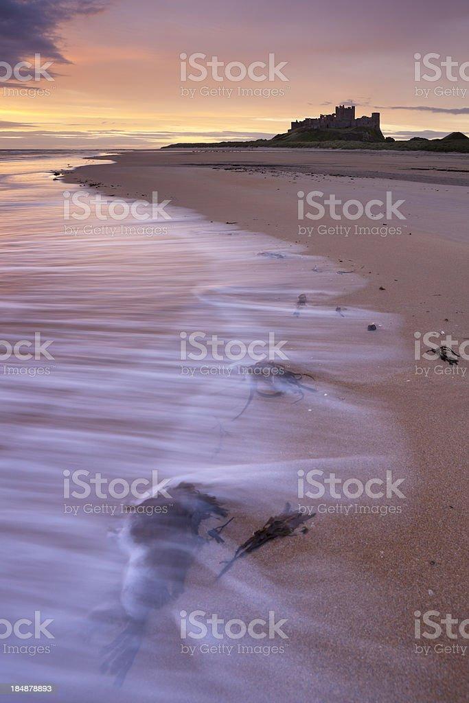 Sunrise on the beach at Bamburgh Castle, Northumberland, England stock photo