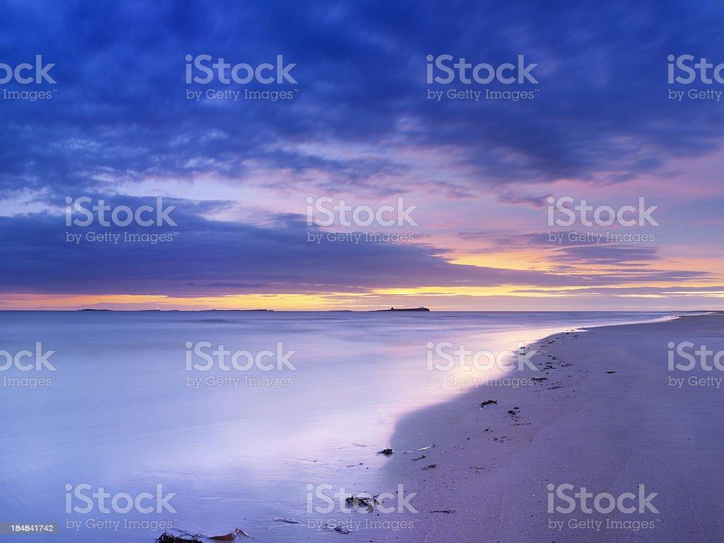 Sunrise on the beach near Bamburgh, Northumberland, England royalty-free stock photo