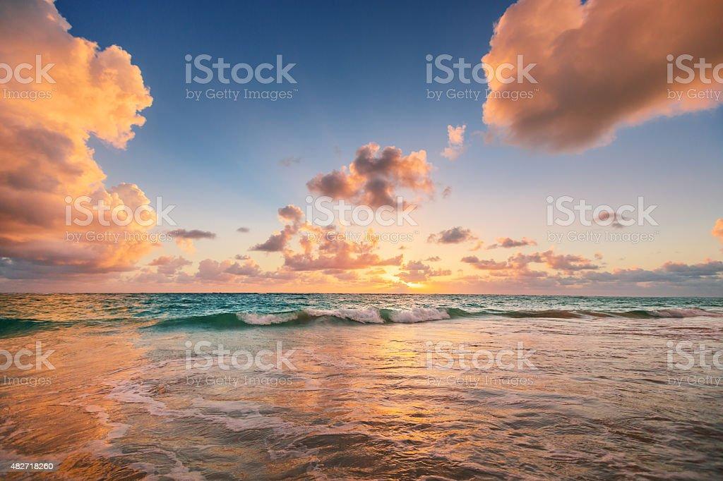 Sunrise on the beach of Caribbean sea stock photo