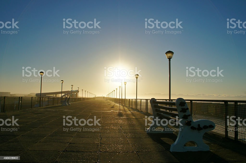 Sunrise on the Boardwalk at Muizenberg Beach in South Africa stock photo