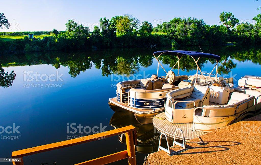 Sunrise on the Lake Pontoon Boat Ready for Summer stock photo