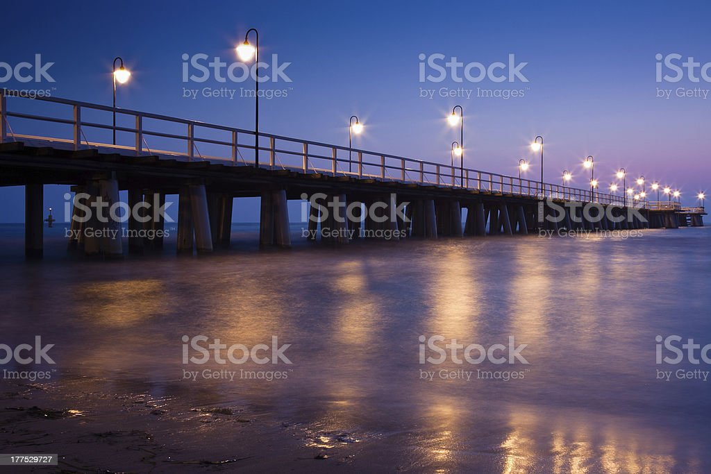 sunrise on the pier at  seaside royalty-free stock photo