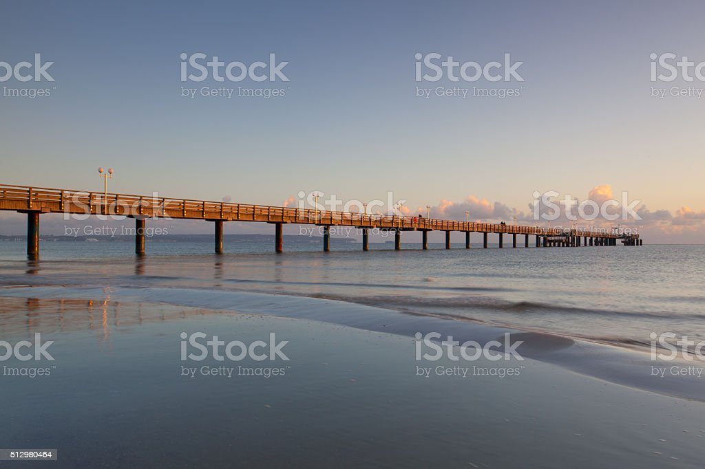 Sunrise on the Pier in Binz, Ruegen Island stock photo
