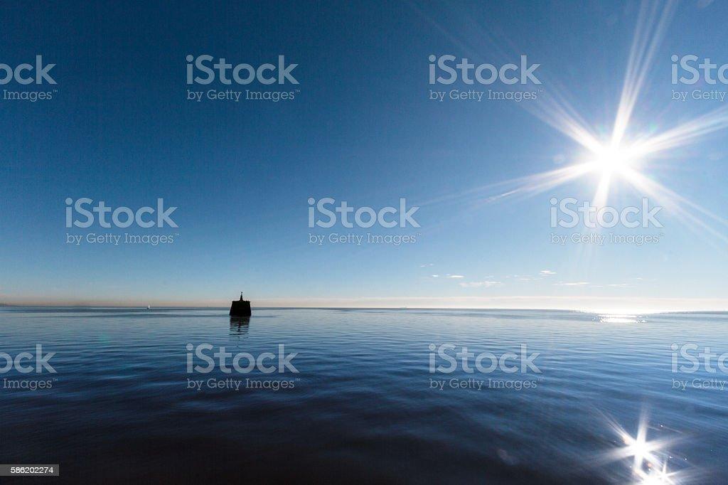 Sunrise on the Rio dela Plata with sun backlighting stock photo