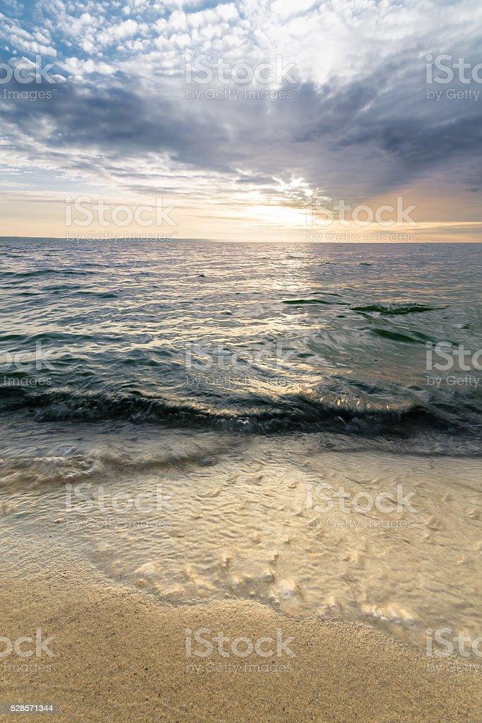 sunrise on the water stock photo