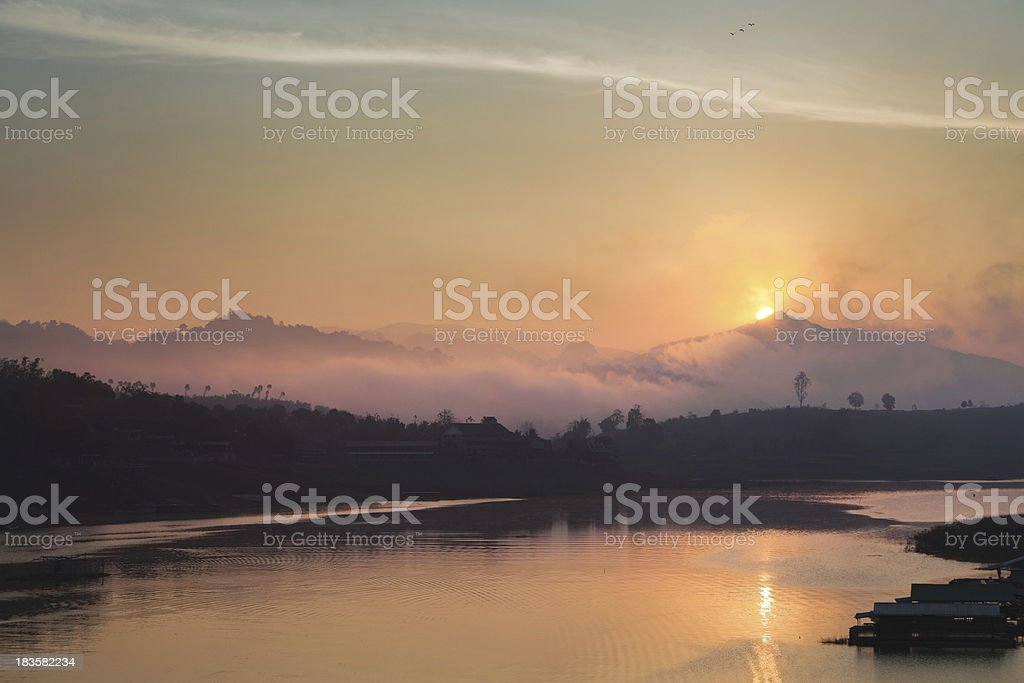 Sunrise over a Lake in the West of Thailand royalty-free stock photo
