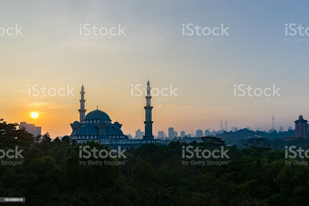 Sunrise over a mosque stock photo