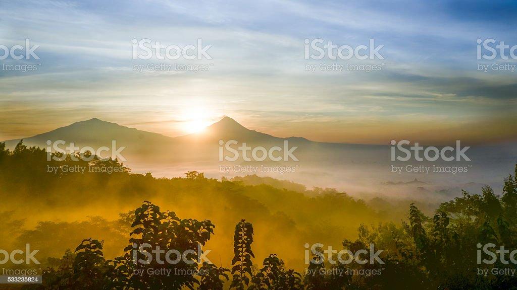 Sunrise over a mountain stock photo