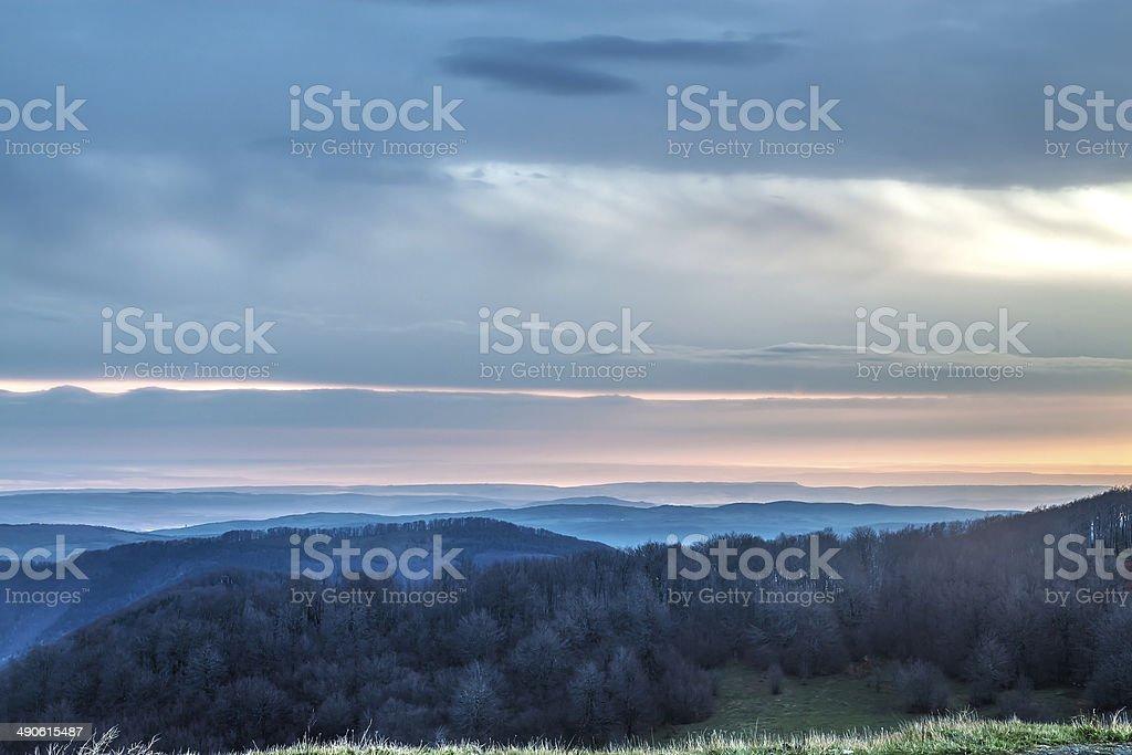 Sunrise over a mountain range stock photo