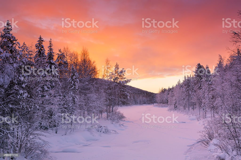 Sunrise over a river in winter near Levi, Finnish Lapland stock photo